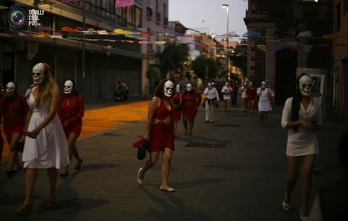 Sex workers wearing skeleton masks